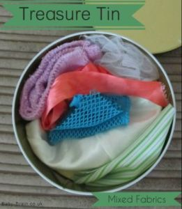 treasure tin, mixed fabrics. Treasure Baskets: what, why & how. baby-brain.co.uk psychology resource perspective babies motherhood & blog