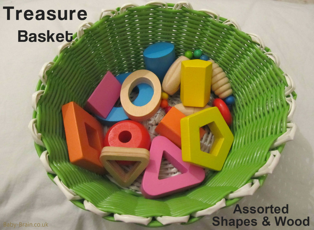 Assorted wooden shapes. treasure baskets and heuristic play: what, why & how. baby-brain.co.uk psychology resource perspective babies motherhood & blog