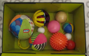 Treasure basket out of a shoe box. Balls. treasure baskets and heuristic play: what, why & how. baby-brain.co.uk psychology resource perspective babies motherhood & blog