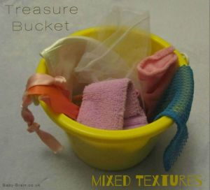 treasure bucket, mixed fabric textures. Treasure Baskets:  what, why & how. baby-brain.co.uk psychology resource perspective babies motherhood & blog
