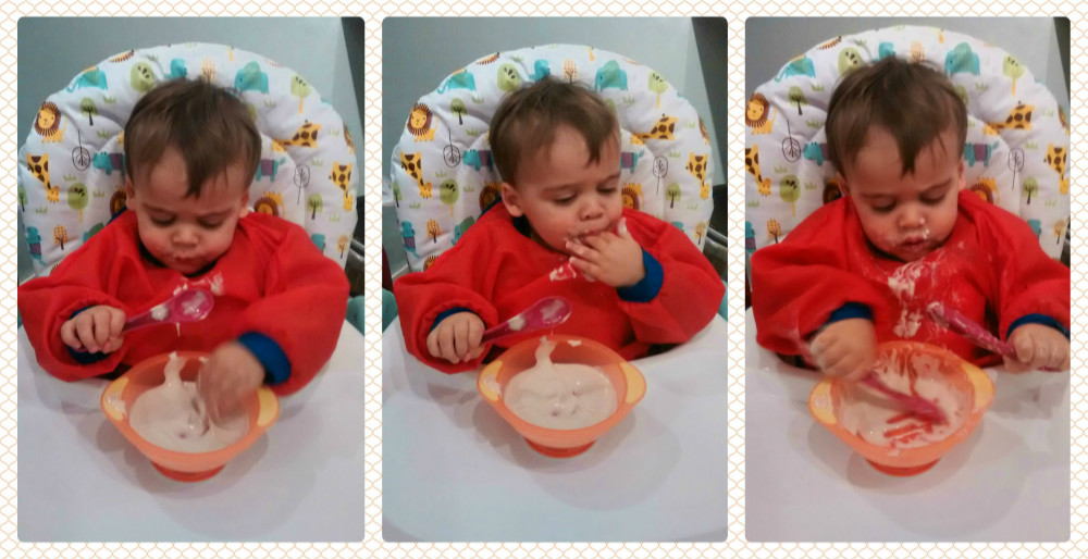 Baby self feeding using spoon and sucky bowl. baby-brain.co.uk