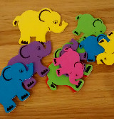 "Monster ""feed me"" lids game - fine motor skill development - fun baby/toddler activity! from baby-brain.co.uk"