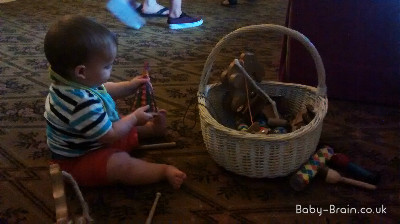 Playing with Victorian style toys at Kensington Palace. Baby Friendly London - places to go with baby. Reviewed by baby-brain.co.uk